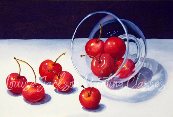Cherries in a clear glass bowl on a white table with a dark watercolor background.